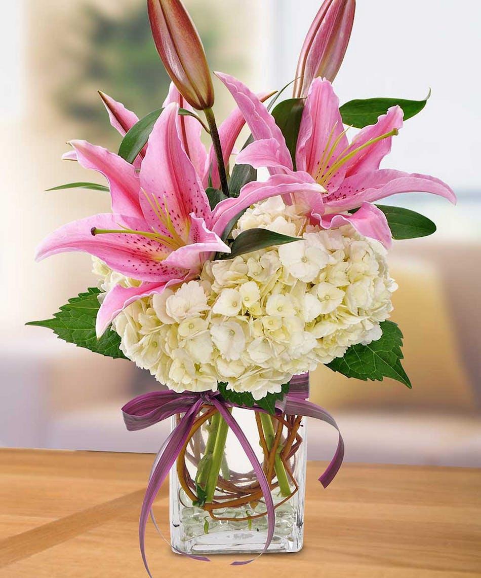 I love lilies floral arrangement in minneapolis mn schaaf floral pink lily and hydrangea floral arrangement izmirmasajfo