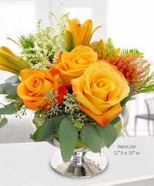 Rose, Lily and Protea Orange Floral Arrangement
