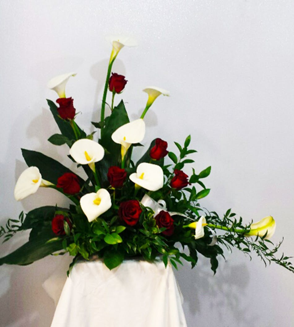 Rose and calla lily funeral arrangement in minneapolis mn schaaf red rose and white calla lily funeral arrangement izmirmasajfo Image collections