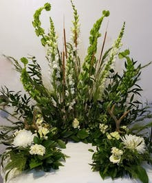 Bells of Ireland, carnations, alstromeria and a wide assortment of of various greens
