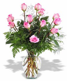 One dozen pink roses in a classic vase.
