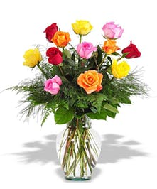 A variety of colors of roses arranged in a classic vase.