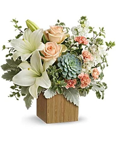 Succulents, peach roses, white asiatic lilies, peach miniature carnations, white stock, along with accent foliage