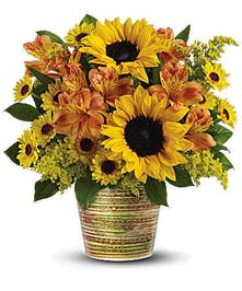 Orange alstroemeria and golden yellow sunflowers combine to make a magnificent statement
