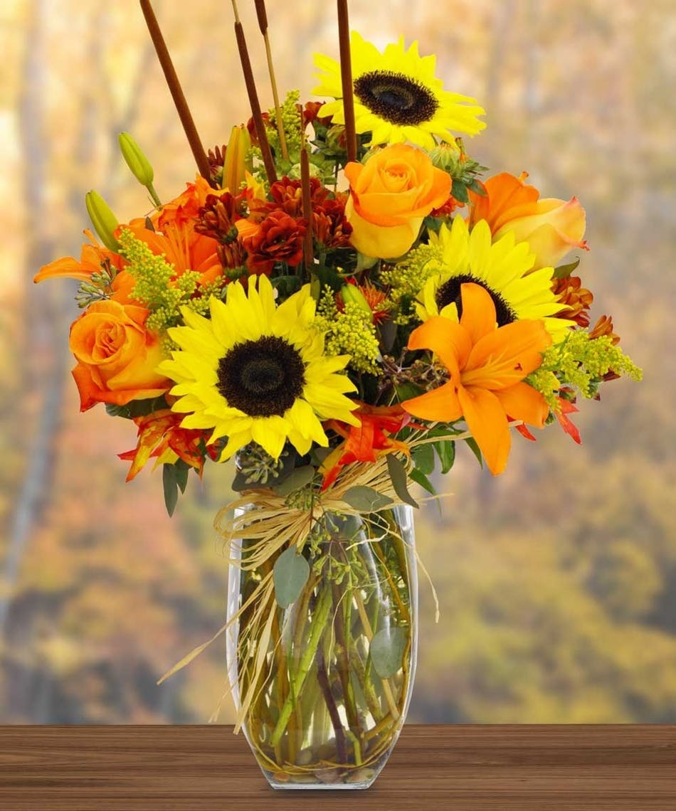 Grand fall bouquet in minneapolis mn schaaf floral sunflower and lily fall arrangement izmirmasajfo