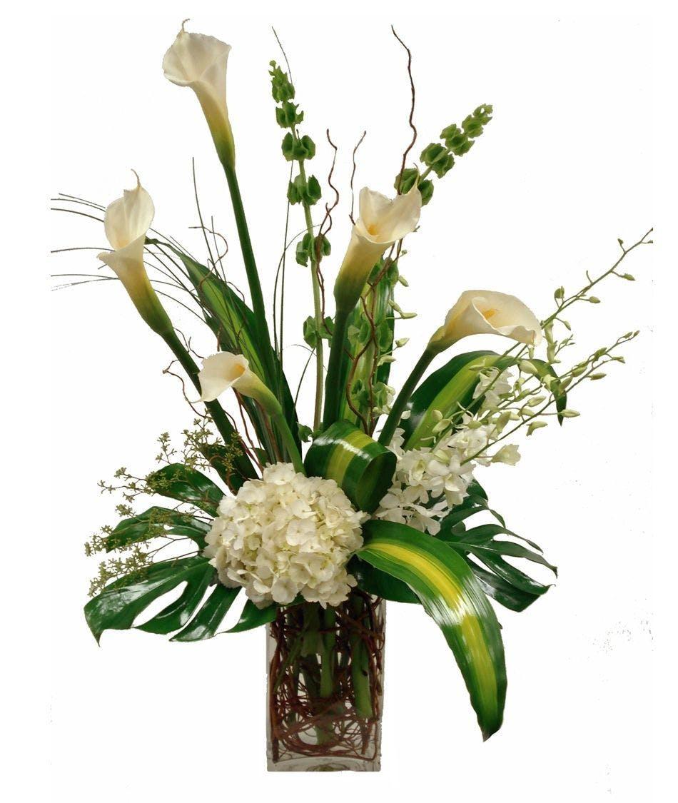 White calla lilies arrangement in minneapolis mn schaaf floral calla lily hydrangea orchid arrangement izmirmasajfo